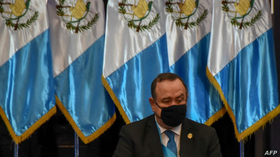 Guatemalan President Alejandro Giammattei prepares to present his government's annual report, at the Culture Palace in…