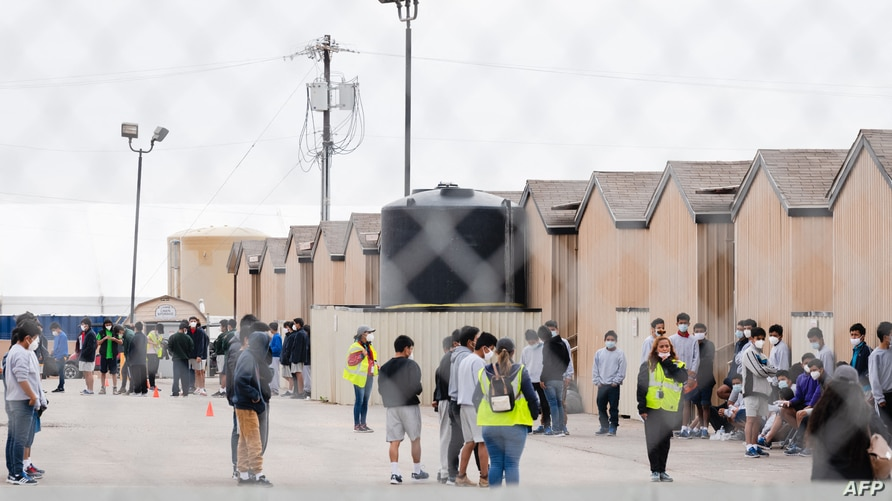 Migrant youths are seen inside the Cotton Logistics oilfield housing that was constructed in 2012 to temporarily house workers…
