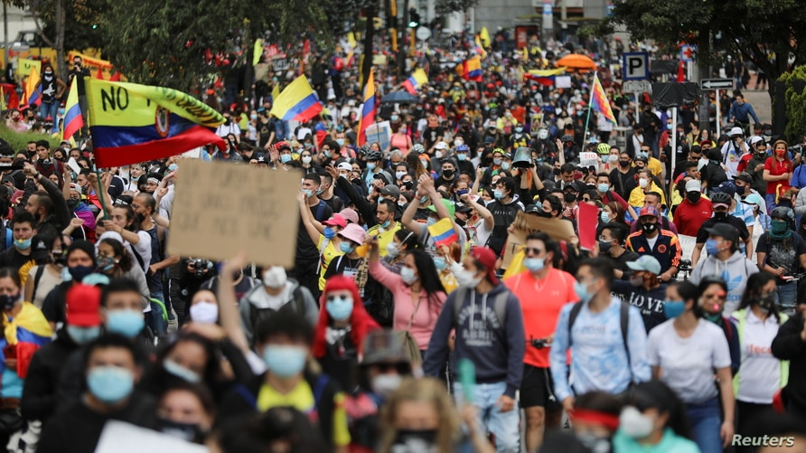 Demonstrators take part in a protest against the tax reform of President Ivan Duque's government in Bogota, Colombia, May 1,…