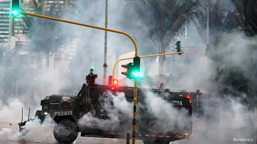 A police armored vehicle is pictured during a protest against poverty and police violence in Bogota, Colombia May 5, 2021.   …