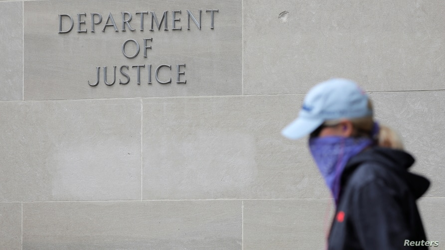 Signage is seen at the headquarters of the United States Department of Justice (DOJ) in Washington, D.C., U.S., May 10, 2021…