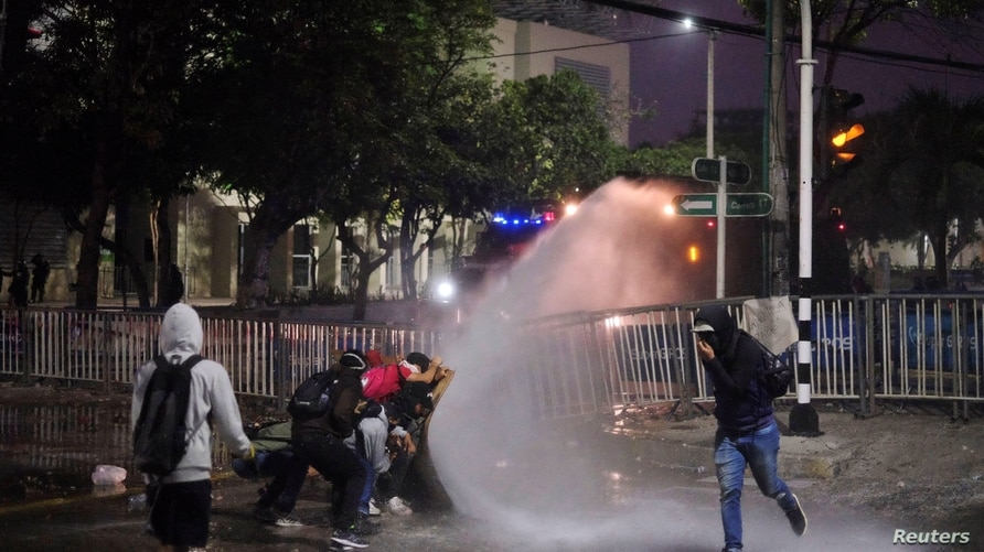 Demonstrators clash with police during a protest against a Copa Libertadores soccer match between America de Cali and Atletico…