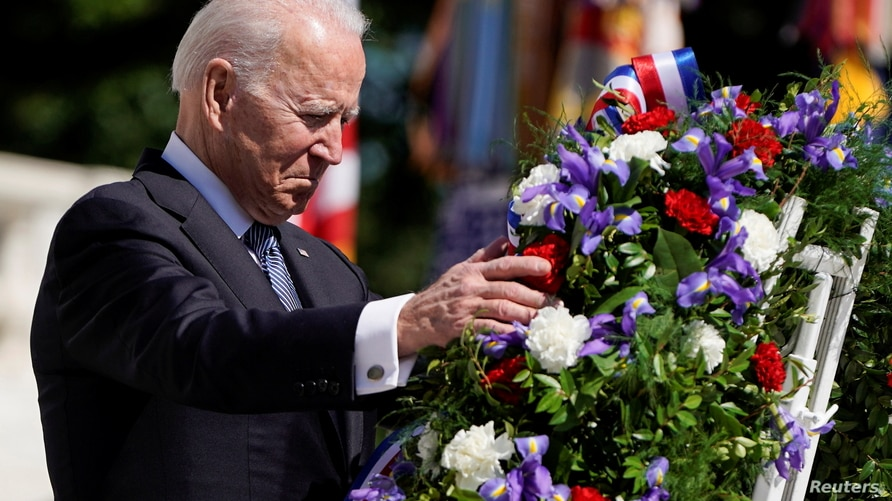 U.S. President Joe Biden takes part in a wreath-laying ceremony during the National Memorial Day observance at Arlington…