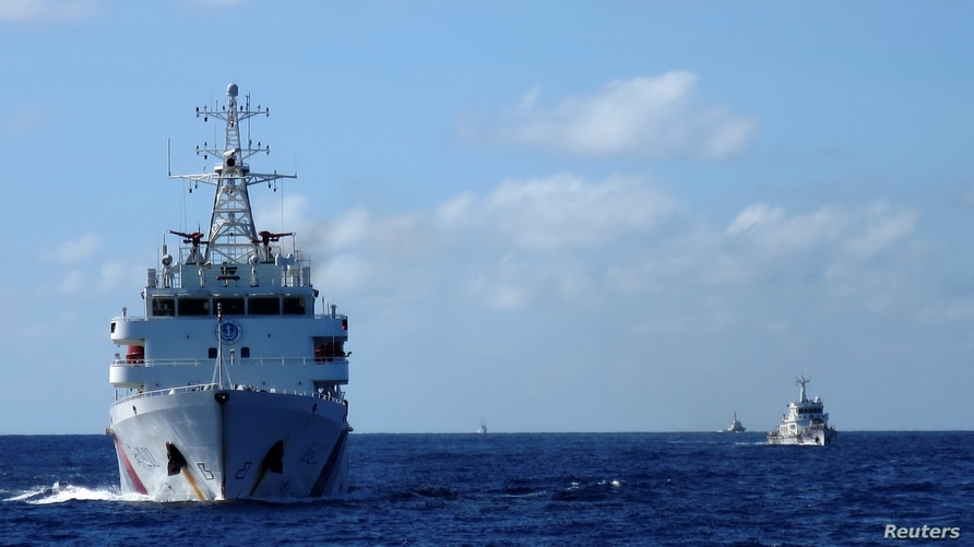 FILE PHOTO: Chinese coastguard ships give chase to Vietnamese coastguard vessels (not pictured) after they came within 10…
