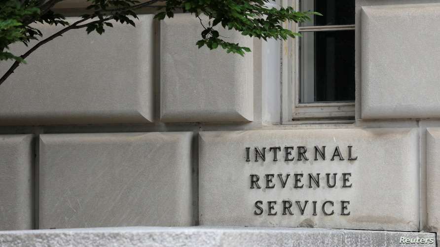 Signage is seen at the headquarters of the Internal Revenue Service (IRS) in Washington, D.C., U.S., May 10, 2021. REUTERS…