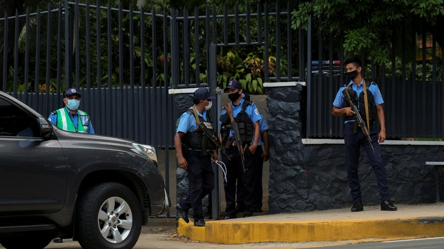 Nicaraguan police officers keep watch at the entrance to the house of opposition leader Cristiana Chamorro after prosecutors…