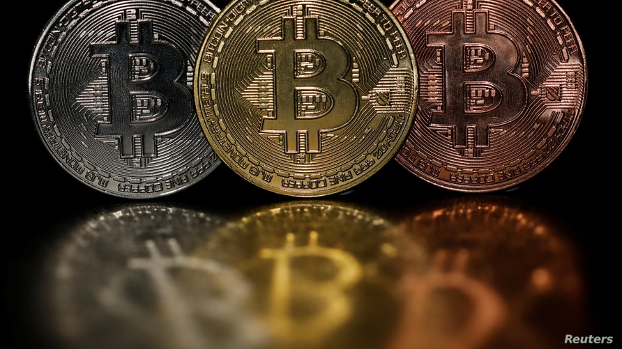 Representations of cryptocurrency Bitcoin are seen in this picture illustration taken June 7, 2021.   REUTERS/Edgar Su…