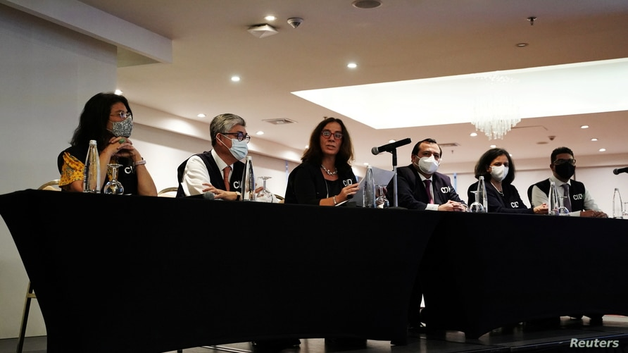 Antonia Urrejola (3rd L), president of the Inter-American Commission on Human Rights (CIDH), addresses the media in Bogota,…