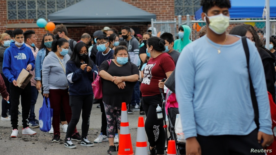 Residents line up for a coronavirus disease (COVID-19) vaccine clinic aimed at youths ages 12 or older at La Colaborativa in…