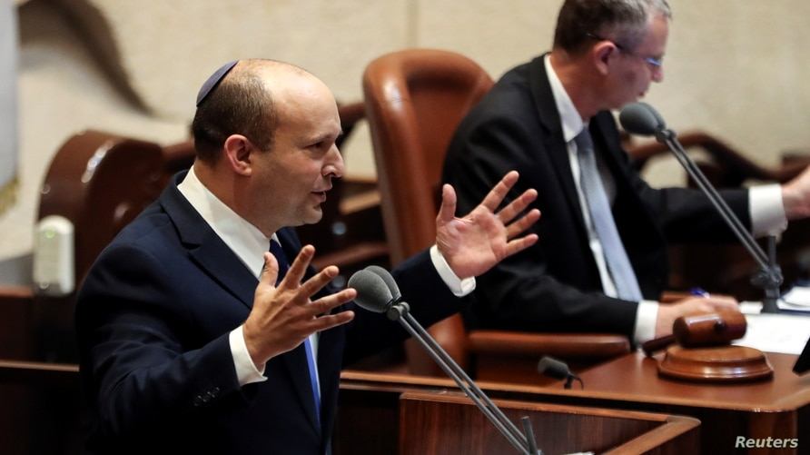 Naftali Bennett, Prime Minister-designate, speaks at the Knesset, Israel's parliament, during a special session whereby a…