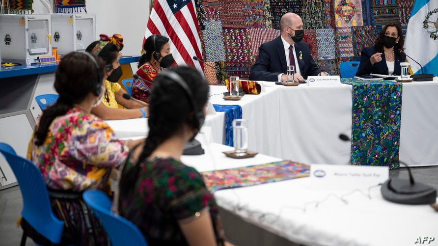 US Vice President Kamala Harris (R) and US Ambassador to Guatemala William Popp (2nd R) participate in a women's…
