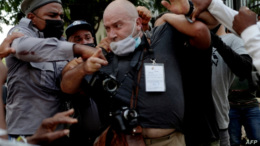 AP photographer, Spanish Ramon Espinosa, is attacked by the police while covering a demonstration against Cuban President…