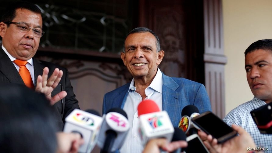 Former President Porfirio Lobo speaks with journalists after handing over his house to the Honduran Administrative Office of…