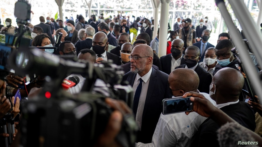 Haitian designated Prime Minister Ariel Henry arrives at a ceremony in the National Pantheon Museum in honor of late Haitian…