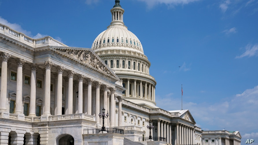 FILE - In this June 14, 2021, file photo the U.S. Capitol is seen in Washington as the House and Senate return to work…