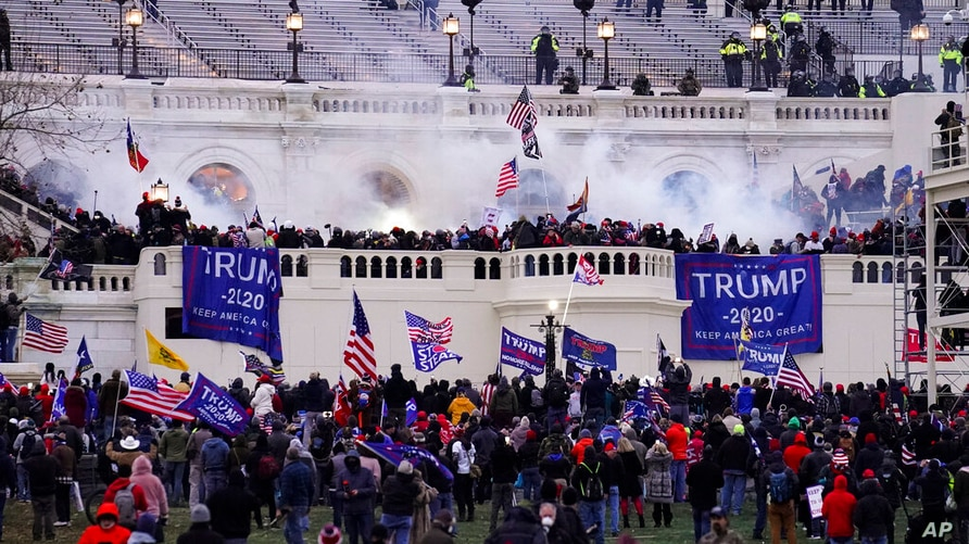 FILE - In this Jan. 6, 2021, file photo, violent protesters, loyal to then-President Donald Trump, storm the Capitol, Wednesday…
