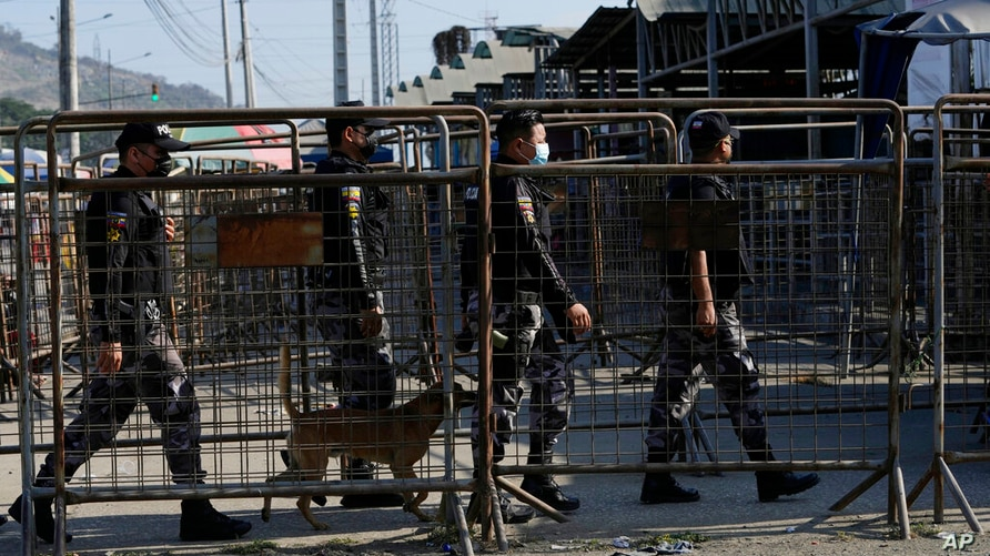 Security forces enter Litoral Penitentiary after deadly fights inside in Guayaquil, Ecuador, Thursday, July 22, 2021. Rival…
