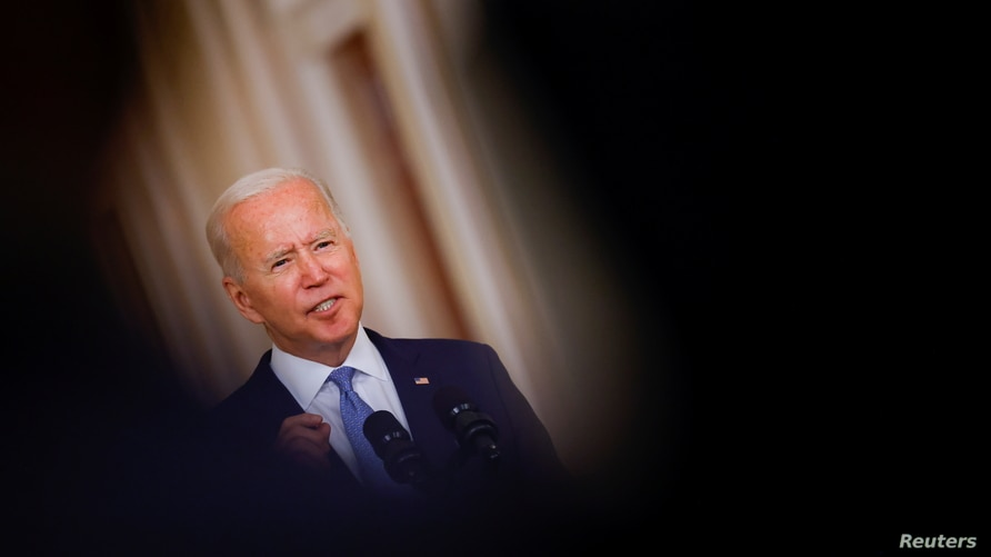 U.S. President Joe Biden delivers remarks on Afghanistan during a speech in the State Dining Room at the White House in…