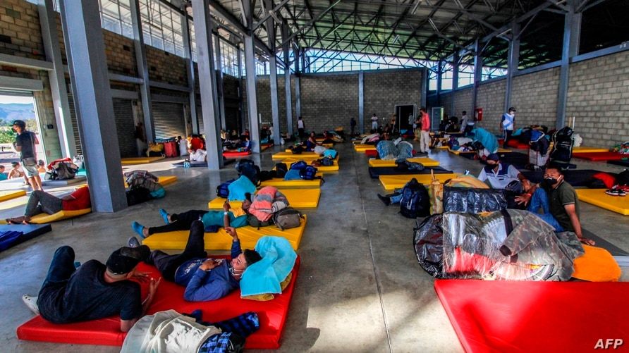 Venezuelan migrants sit on mattresses in a building at the Tienditas International Bridge in Cucuta, Colombia, on the border…