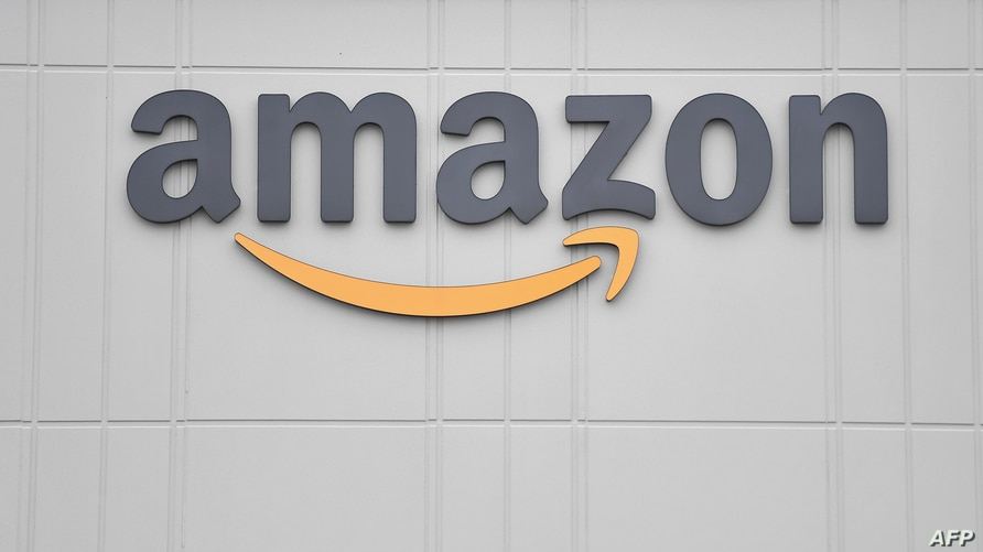 (FILES) In this file photo taken on December 17, 2019 this picture shows the logo of US online retail giant Amazon at the…