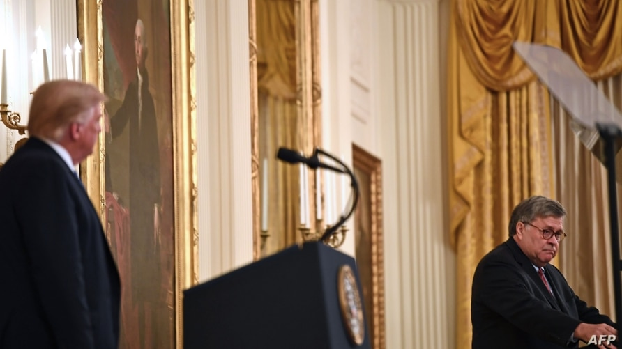 """US President Donald Trump (L) listens to US Attorney General William Barr deliver remarks on """"Operation Legend: Combatting…"""