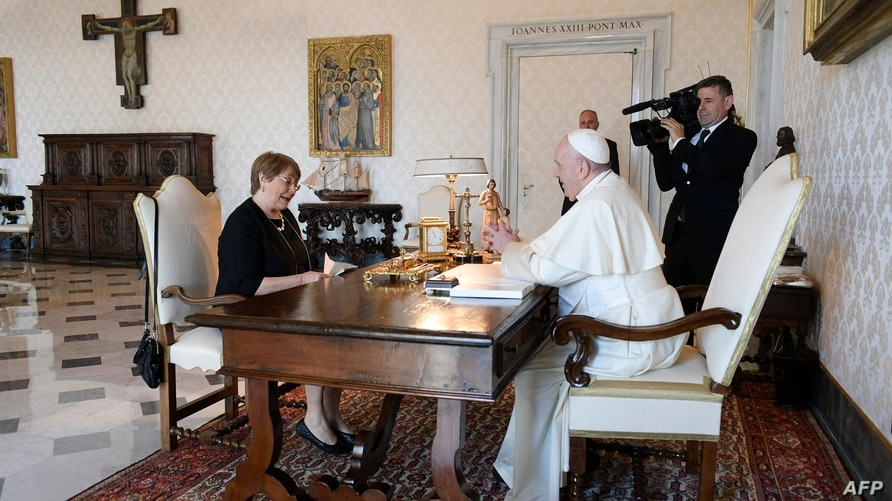 This handout photograph taken on August 12, 2020, and released by the Vatican press office Vatican Media, shows Pope Francis (R…