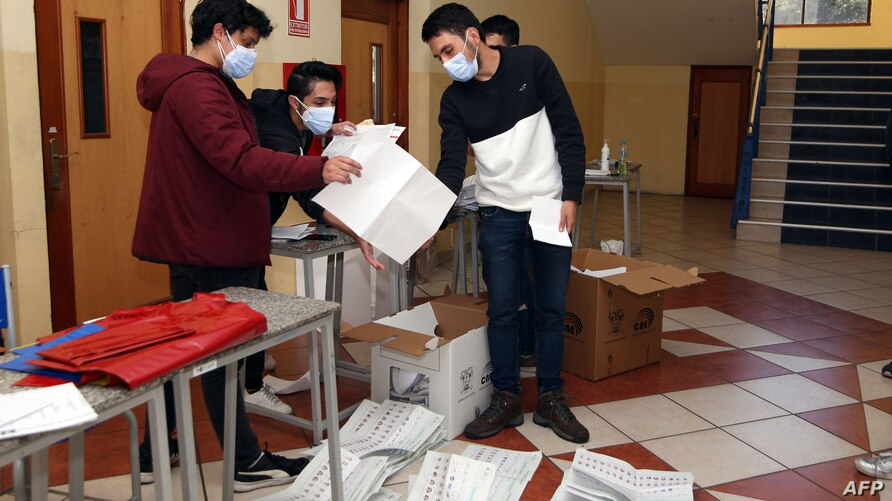 The vote count is carried out at the Salesian Higher Technical Institute in Cuenca, Ecuador, on February 7, 2021, after…