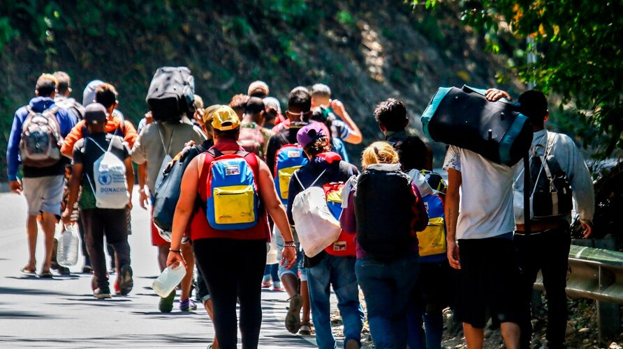 Venezuelan migrants walk along a highway in Cucuta, Colombia, on the border with Venezuela, on February 2, 2021, amid the COVID…