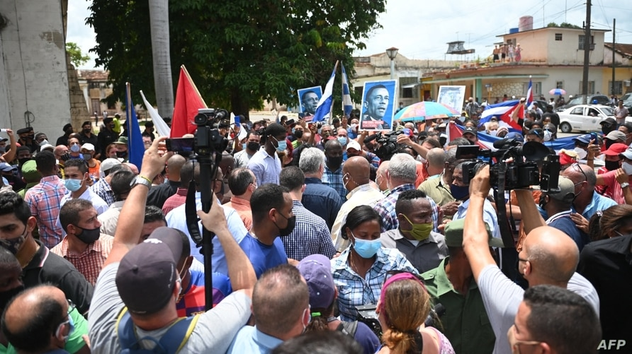 Cuban President Miguel Diaz-Canel (C) is seen during a demonstration held by citizens to demand improvements in the country, in…
