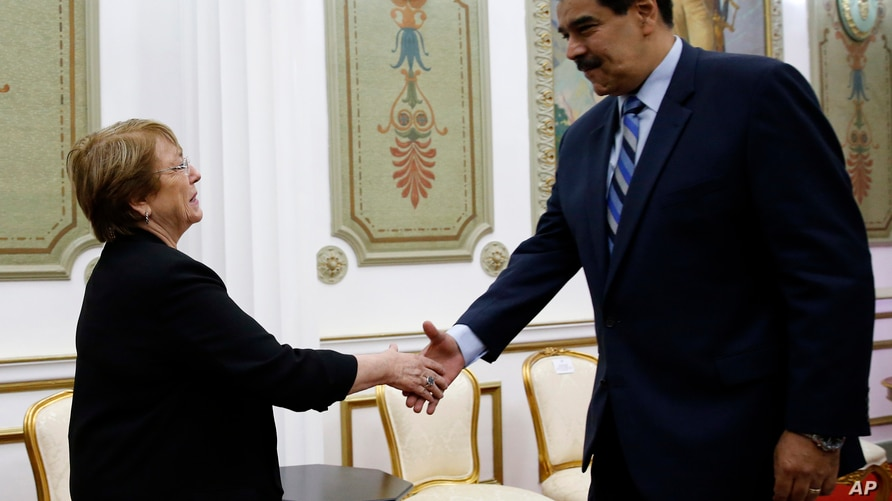 U.N. High Commissioner for Human Rights Michelle Bachelet, left, is greeted by Venezuela's President Nicolas Maduro, at…