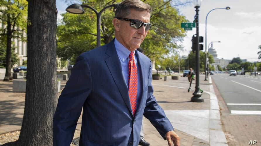 FILE - In this Sept. 10, 2019 file photo, Michael Flynn, President Donald Trump's former national security adviser, leaves the…