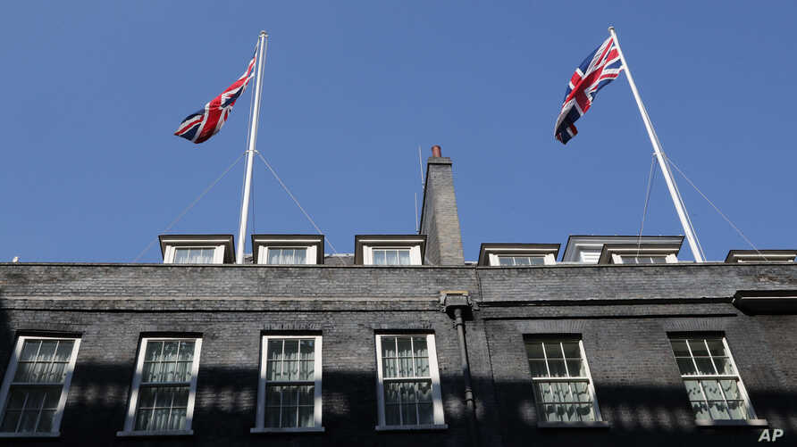 Two Union flags fly above Downing Street in London after it was announced that British Prime Minister Boris Johnson has tested…
