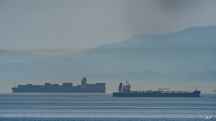 A view of the vessel the Clavel, right, sailing on international waters crossing the Gibraltar stretch on Wednesday, May 20,…