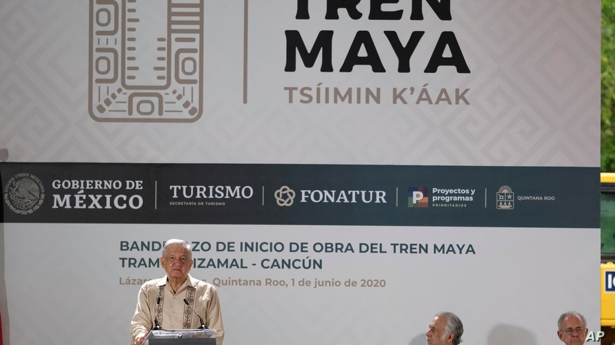 Mexican President Andres Manuel Lopez Obrador, left, speak during a ceremony in Lazaro Cardenas, Quintana Roo state, Mexico,…