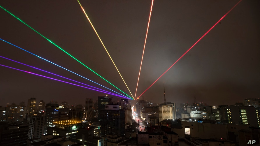 The Global Rainbow, a large scale outdoor laser projection created by New York artist Yvette Mattern is projected into the…