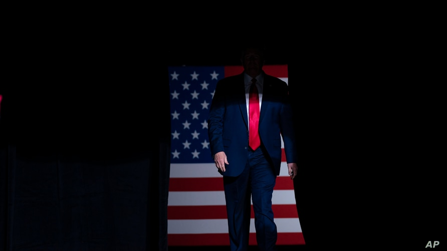 President Donald Trump arrives on stage to speak at a campaign rally at the BOK Center, Saturday, June 20, 2020, in Tulsa, Okla…