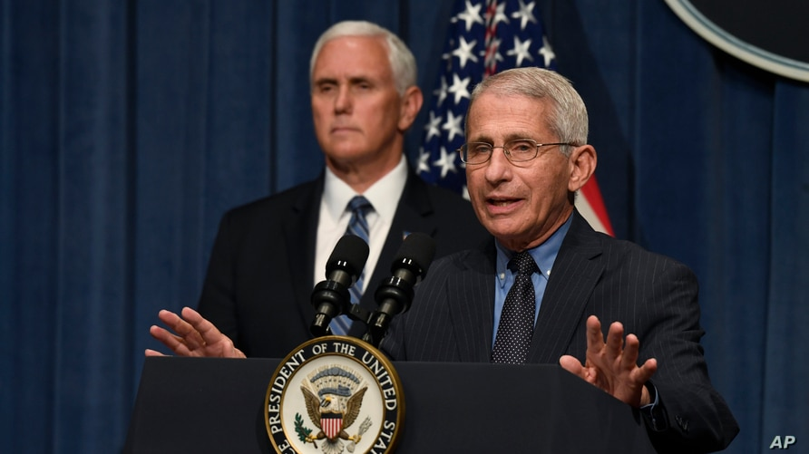 Dr. Anthony Fauci, right, director of the National Institute of Allergy and Infectious Diseases, speaks during a briefing with…