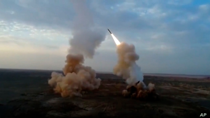 This video grab shows launching underground ballistic missiles by the Iranian Revolutionary Guard during a military exercise…