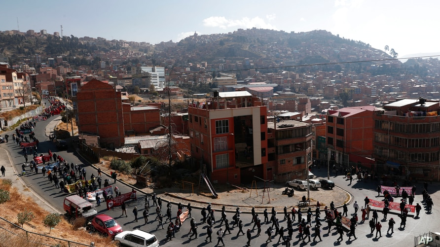Demonstrators protest against the government's response to the COVID-19 pandemic in La Paz, Bolivia, Tuesday, July 14, 2020…