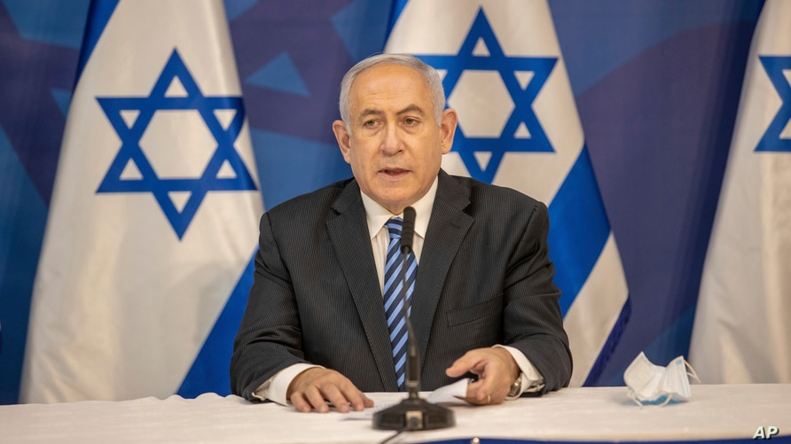 Israeli Prime Minister Benjamin Netanyahu issues a statement at the Israeli Defense Ministry in Tel Aviv, Israel, Monday, July…