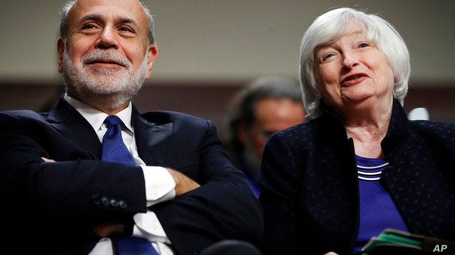 FILE - In this Nov. 7, 2017, file photo, former Federal Reserve Chair Ben Bernanke, left, and then-Federal Reserve Chair Janet…