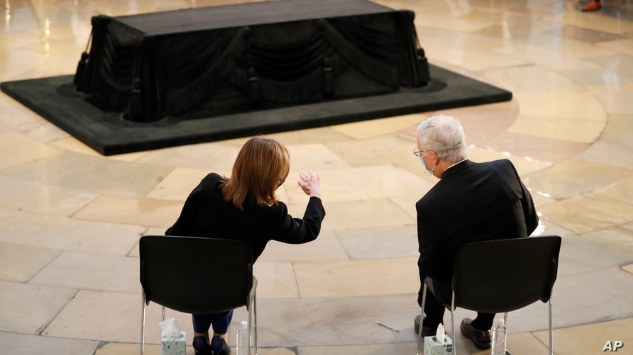 House Speaker Nancy Pelosi of Calif., left, and Senate Majority Leader Mitch McConnell of Ky., talk prior to a memorial service…
