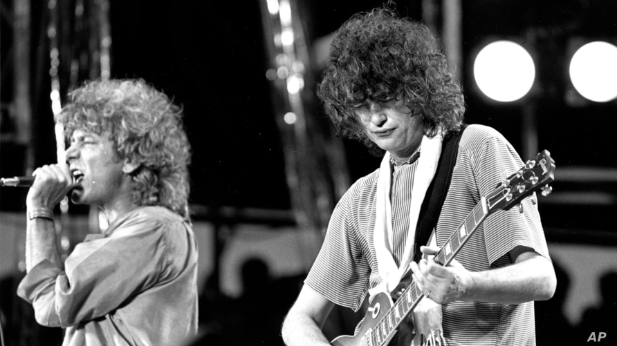 FILE - In this July 13, 1985 file photo, singer Robert Plant, left, and guitarist Jimmy Page of the British rock band Led…