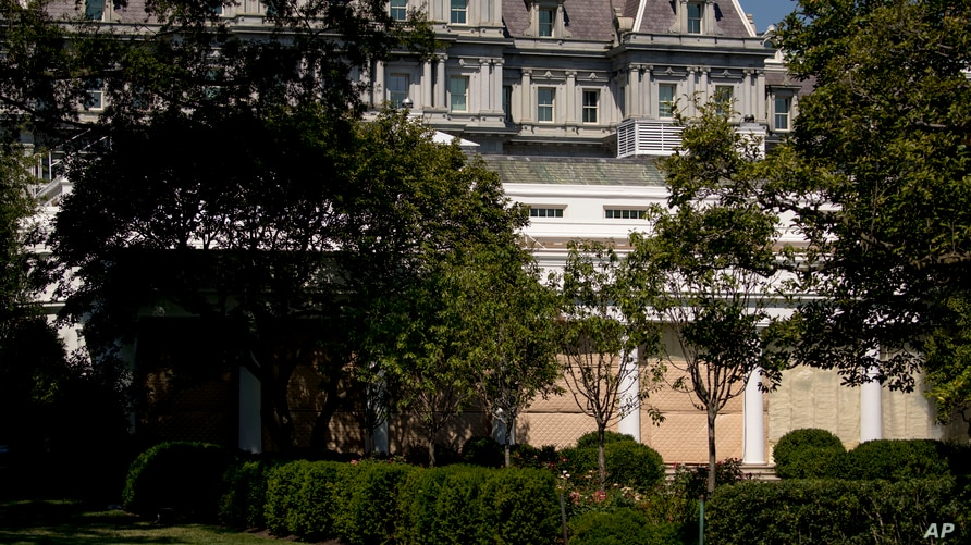 Tarps are up along the colonnade as a renovation project will get underway of the Rose Garden at the White House in Washington,…