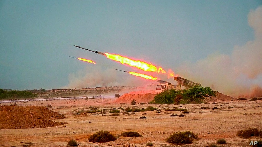 In this photo released Tuesday, July 28, 2020, by Sepahnews, missiles are fired in a Revolutionary Guard military exercise…