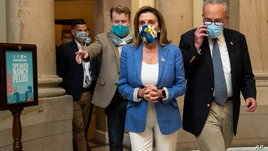 House Speaker Nancy Pelosi of Calif., and Senate Minority Leader Chuck Schumer of N.Y., walk from Pelosi's office following a…