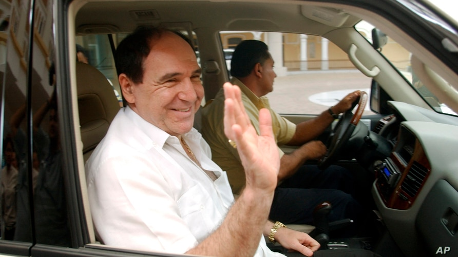 FILE - In this May 6, 2005 file photo, former Ecuadorean President Abdala Bucaram leaves the Foreign Ministery in Panama City,…