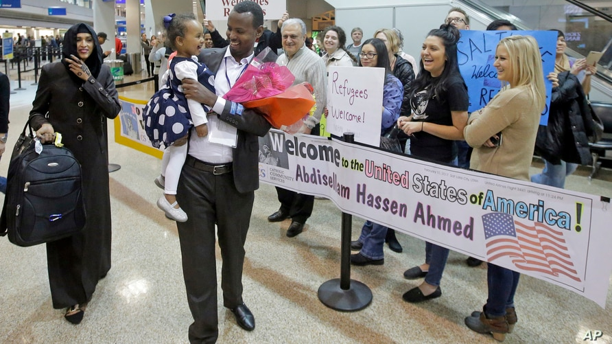 FILE - This Feb. 10, 2017, file photo, Abdisellam Hassen Ahmed, a Somali refugee who had been stuck in limbo after President…