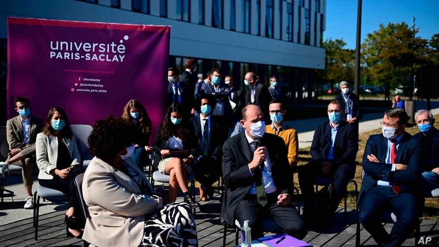 French Prime Minister Jean Castex , wearing a protective face mask due to the COVID-19 coronavirus pandemic, speaks next to…