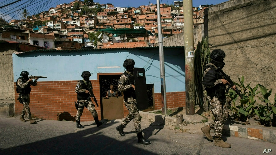 Members the National Police Action Force, or FAES, an elite commando unit created for anti-gang operations, patrol the Antimano…